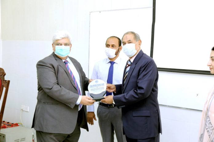 FINCA donates to IPH - Mubashar Bashir, CFO, FINCA Pakistan, receiving appreciation shield from The Chairman Board of Management, Institute of Public Health, Lt. Gen. (Rtd.) Khalid Maqbool